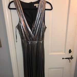 Francesca's silver jump suit ,  size medium